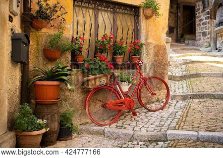 Red Bicycle And Flowers On Castro Del Volsci Street, Fronzinone, Italy