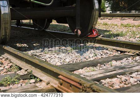 Brake Shoe Of Rail Wheel Of Train On The Rail.