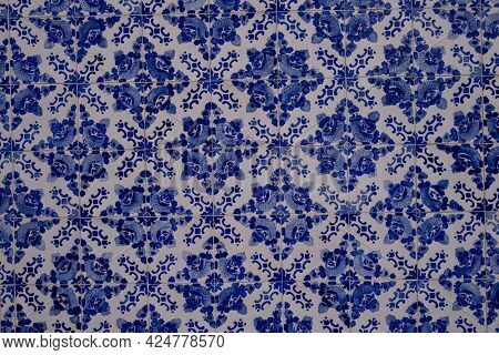 Old tiles wall on the street azulejos ceramic tilework. Porto, Portugal.