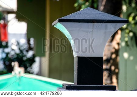 Stock Photo Of Modern Electric Black Color Conical Shaped Lamp Installed On Front Gate Of Indian Hou