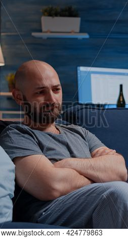 Stressed Depressed Traumatised, Frustrated Man Looking In Distance, Sitting Alone On Sofa Feeling Em