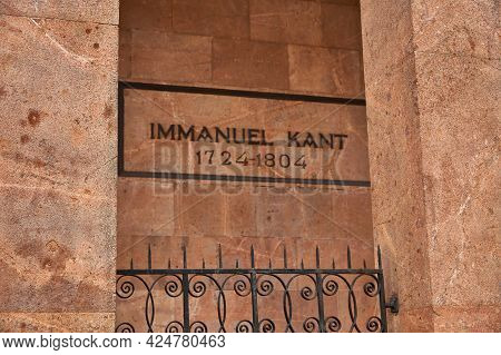 Immanuel Kant Plaque With Years Of Life On A Brick Wall In An Ointment Behind A Fence.