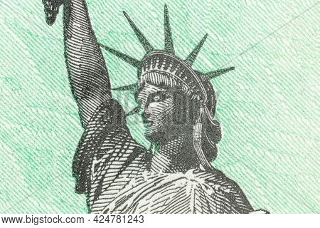 Macro detail of the Statue of Liberty on a United States Treasury check.