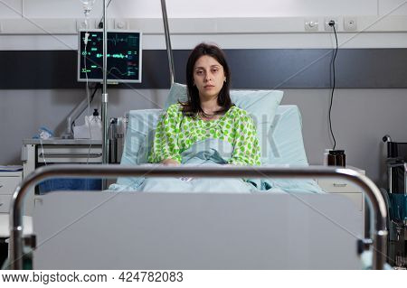 Portrait Of Sad Patient Lying In Hospital Bed Recovering After Surgery. Hospitalized Woman Waiting G