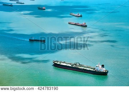 Aerial View Of Container Ships In Singapore Strait. Airplane Shot. Cargo Ships Anchored In The Road,