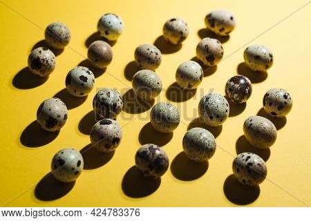 Quail Eggs On Pastel Yellow Background. Minimal Happy Easter Composition. Minimalism Or Healthy Life