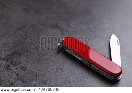 Modern Compact Portable Multitool On Grey Table. Space For Text