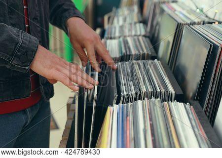 Man Choosing Vinyl Records In Store, Closeup