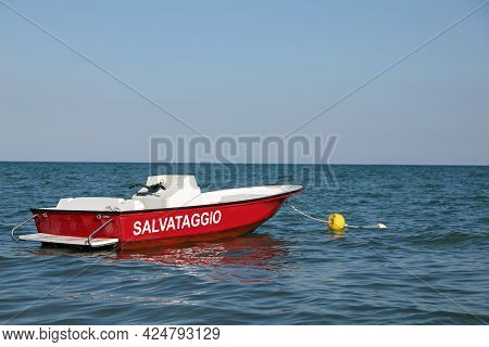 Speedboat In The Sea To Carry Out The Rescue Of The Bathers Who Are Drowning With The Text In Italia