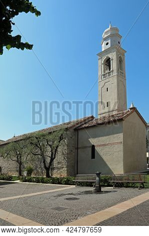Olive Tree And The Church Tower Of The Small Town Called Lazise On The Shores Of Lake Garda In The V