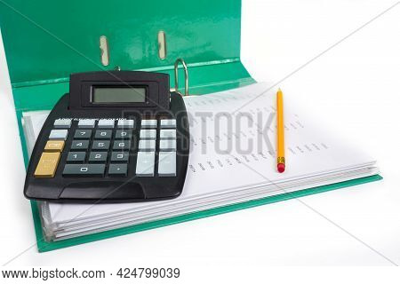 Open File With Calculator And Pencil. Bookkeeping Concept