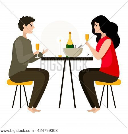 Young Beautiful Couple Having Dinner At Home By Candlelight Drinking Champagne. Romantic Dinner At H