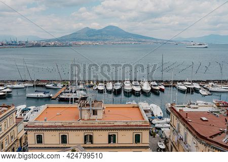 Boats docked at a pier in Naples, Italy