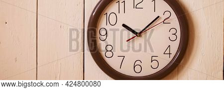 Clock on wooden wall. Flat lay. Mock up. flat lay template wooden plank table and clock