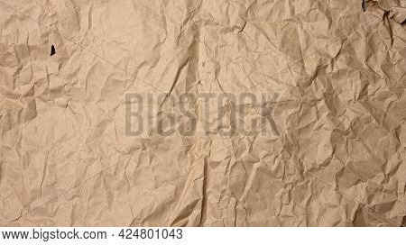 Crumpled Blank Sheet Of Brown Wrapping Kraft Paper, Vintage Texture For The Designer, Full Frame, Ba