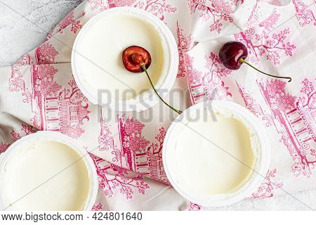 Fresh ripped cherries on greek yogurt flatlay