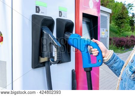 Electric Car Charging Station. Power Cable Pump Plug In Recharge Fuel Technology With Cable To Power