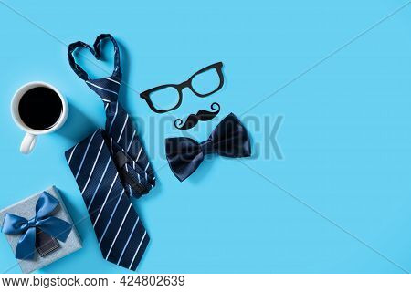 Father's Day Gift Design Concept. Top View Of Paper Decoration With Necktie And Gift On Blue Table B