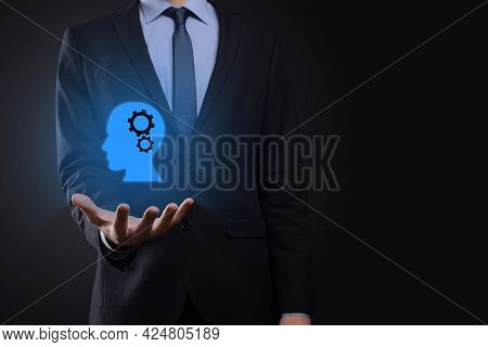 Businessman Man Holding A Man Icon With Gears In His Head. Artificial Intelligence. Technology Advan
