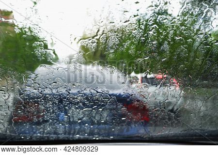 Driving A Car In Bad Weather. Driving In A Car In Heavy Rain. Difficult Visibility From A Car Throug