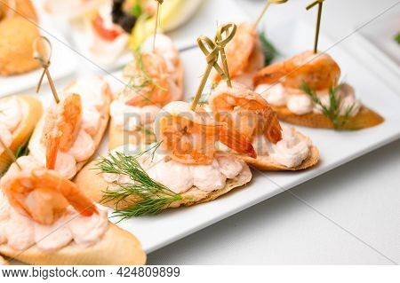 Appetizer Canape With Shrimp And Sauce And White Bread On Plate On Table.