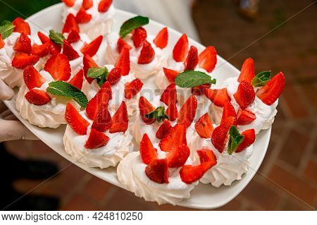 Anna Pavlova Meringue With Low-fat Whipped Cream And Fresh Strawberry On Tray
