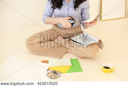 Young Brunette Woman Creating Her Feng Shui Wish Map. Dreams And Wishes