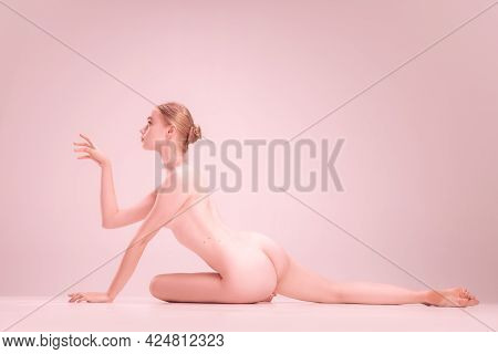 Graceful Fragile Young Naked Beautiful Girl Posing Isolated On Pink Studio Background. Concept Of Be