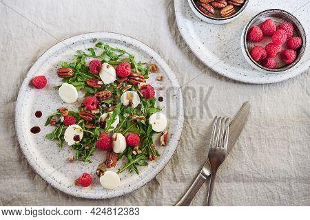 Summer Salad With Arugula, Raspberries, Mozzarella Cheese And Pecan Nuts. Morning, Breakfast, Health