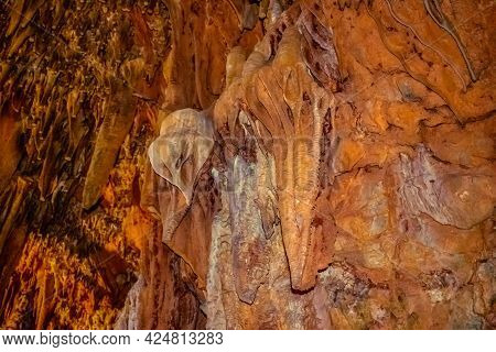 Brown Stone Mineral Formations On The Wall In Damlatas Cave In Alanya (turkey), Close-up. Natural Ab