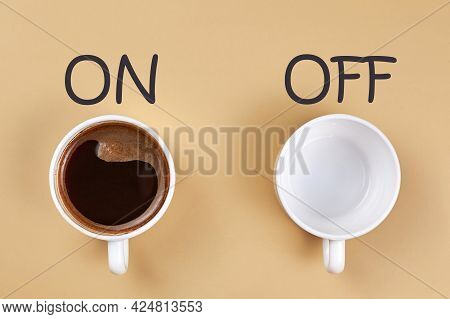 Cup Filled With Coffee And Empty Cup On Beige Background, Lettering On And Off.