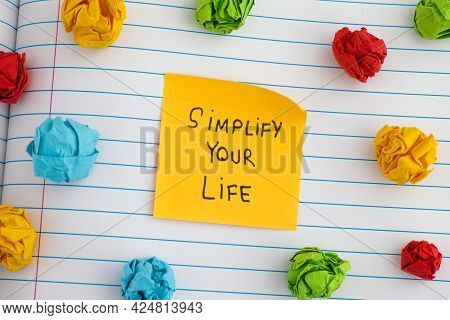 Simplify Your Life. A Yellow Paper Note With The Phrase Simplify Your Life On It With Some Colorful