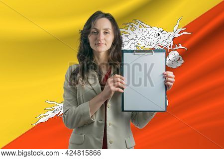 Study In Butane. Beautiful Woman Holding A Sheet Of Paper In Her Hands. Girl On The Background Of Th