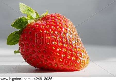 Picture Of One Strawberry Background, Strawberry On White Table Or Surface, Close Up, Macro, One Red