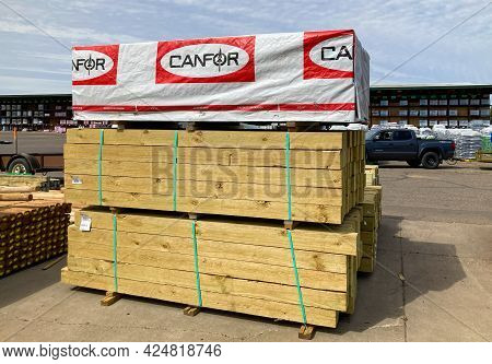 Pallet Of Canfor Corporation Stacked Lumber In Exterior Lumbar Yard