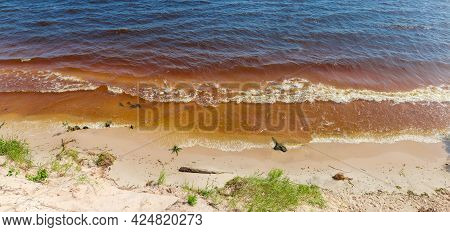 Section Of Shoreline Of The Reservoir Sandy Shore With Rolling Waves, Panoramic View