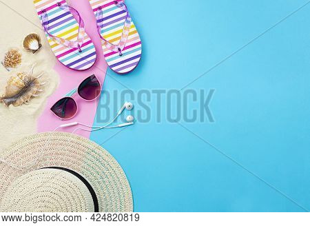 Trendy Summer Background With Empty Space For Text. Summer Leisure Items Are Laid Out On A Blue And