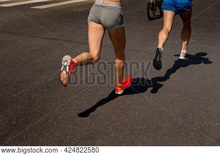 Couple Joggers Athletes Woman And Man Run In Dark Road