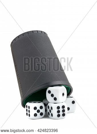 Five White Dice Lying Underneath A Black Shaker Cup On A White Background
