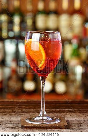 Light Refreshing Italian Aperitif Apelol Spritz Stands On The Bar In A Restaurant Or In A Nightclub.