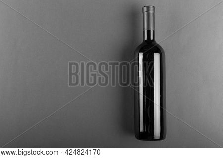 Corked Bottle Of Red Wine On A Gray Background. Alcoholic Drink. Winemaking Concept.