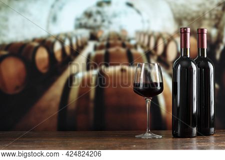 Wine Cellar With A Bottle Of Wine And Glasses. Winemaking Concept. Space For Text.