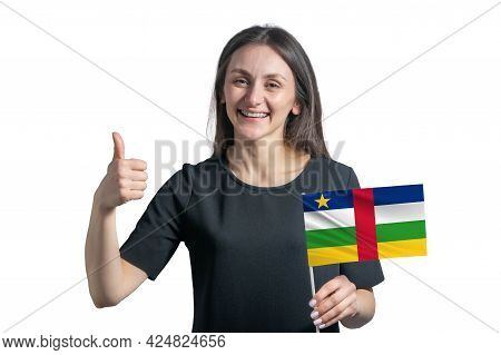 Happy Young White Woman Holding Flag Of Central African Republic And Shows The Class By Hand Isolate