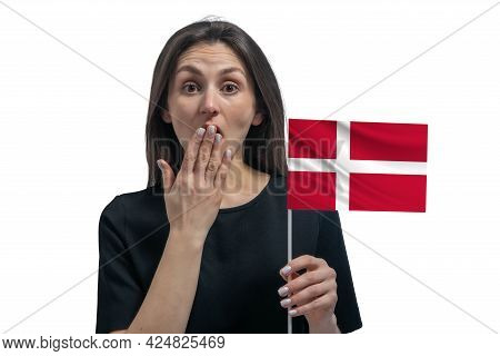 Happy Young White Woman Holding Flag Of Denmark And Covers Her Mouth With Her Hand Isolated On A Whi