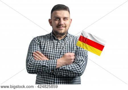 White Guy Holding A Flag Of South Ossetia Smiling Confident With Crossed Arms Isolated On A White Ba