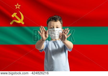 Little White Boy In A Protective Mask On The Background Of The Flag Of Transnistria. Makes A Stop Si