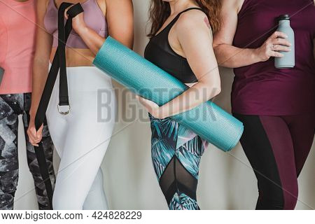 Group of sportive people in yoga class