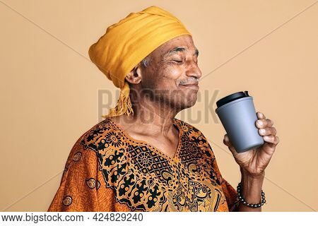 Senior mixed Indian man drinking coffee from a tumbler mockup