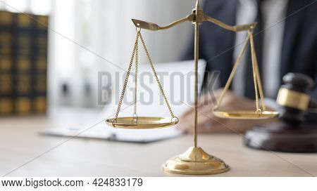 Lawyers or judges sign documents in accordance with legal and fair terms of agreement, Legal Ethics