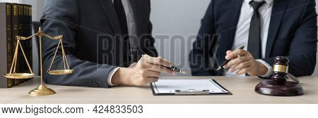 Lawyer or judge has recommend a client sign a legal agreement in the courtroom, Legal Agreement Docu